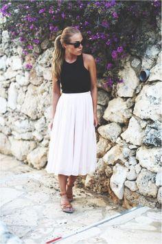 Black tank, white midi skirt, and tan strappy sandals