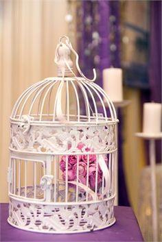 Bridecage with purple flowers