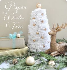 a paper winter tree created with cardstock and cupcake liners. It reminds me of a combination between those bottle brush trees and all the coffee filter crafts we've seen this past year. Thanks @Centsational Girl!