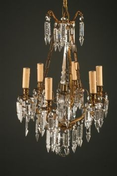 Antique French six arm iron and crystal antique chandelier, circa 1880. #antique #chandelier #iron #crystal