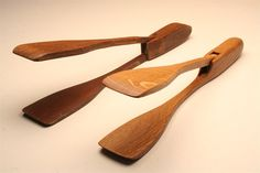 Wooden salad tongs kitchen utensil reproduced from an antique design.