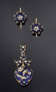 A 19th century diamond and enamel heart pendant and earrings The pendant with old-cut diamond floral motif against a translucent blue enamel field, the engraved reverse with glazed heart shaped locket compartment containing hair, suspended from a ribbon surmount, circa 1860,; the circular earrings of blue enamel boss design with applied rose-cut diamond flowerhead and collet detail, hook fittings
