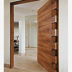 We love the hinge work on this solid timber door! What do you think- yes, or no?! #DesignPoll