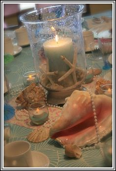 """candle, white startifsh, and shells....""""sprinkle"""" shells on the table"""