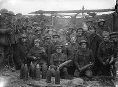 MINISTRY INFORMATION FIRST WORLD WAR OFFICIAL COLLECTION (Q 1538)   Personnel a 4.5-inch howitzer battery; Thiepval September 1916.  Shells and cigarettes.