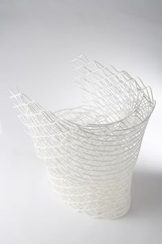 """Diamond"" chair in white, based on the atomic structure of diamonds 