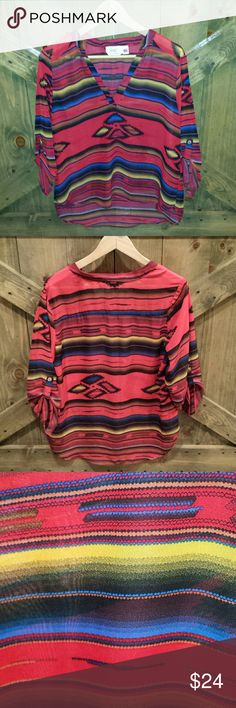 Sheer Zarape Print Blouse Love this colorful top with hi front, low back. No rips or snags. Excellent condition. Rock it with black leggings, boots and a super cute cowboy hat!!! Comes with extra button for sleeves. No size listed. About a M/L Tops Blouses