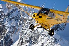 Yellow Piper Super Cub in the Neacola Mountains, Alaska