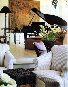 I love the ticking armchairs and the black lamp to balance the grand piano.