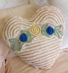 ivory chenille heart pillow with blue and yellow flowers