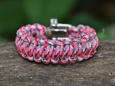 A bracelet made from military paracord, how cool is that? It's really neat and unravels into a full rope for survival situations. Jewelry that could save your life!