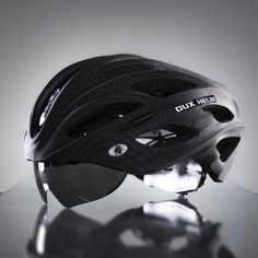 """The Dux Helm Premium in Carbon Black is the world's first cycling helmet with """"True"""" Retractable Lens System, where the lens hides within the helmet frame. Lens System allows for quick and convenient lens replacement and can accommodate any wea. Cycling Helmet, Cycling Gear, Bike Helmets, Bicycle Helmet, Retractable Shade, Mens Gear, Carbon Black, First World, Kayaking"""