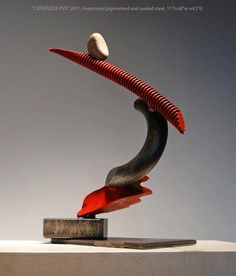 """Catapulta XVII by John Van Alstine. River stone and pigmented and sealed steel. 11"""" x 8"""" x 4.5"""". For questions or prices please contact us at info@igifa.com."""