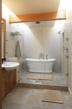 not sure if i love this.. but it draws me in.. TUB AND SHOWER IN SAME AREA??? via Houzz