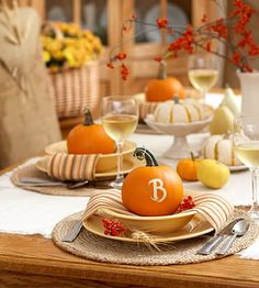 60 Stylish Table Settings for Thanksgiving - Tablescape Ideas and Inspiration...I really like the idea of the monogrammed pumpkins!