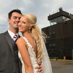 Aviation wedding photo with the control tower in the background!! athen's airport?