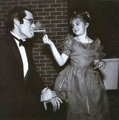 9-year-old Drew Barrymore lights Stephen King's cigarette at the Maine premiere of Firestarter in 1984 ...