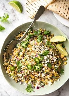 """A terrific way to use corn, this Mexican Corn Salad is inspired by the famous Mexican street corn """"Esquites"""". This is Can't-Stop-Eating-It delicious!"""