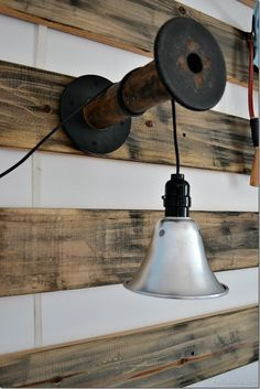 I like this idea of using a vintage bobbin or reel to hang non mains wired lights...