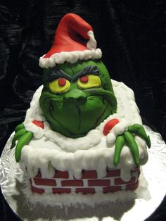 """Red Velvet Cake """"Grinch"""" made for a fundraiser. All cake no RCT. 100% edible. It does not show up in the photo, but the snow is dusted with disco dust and is very sparkly = )"""