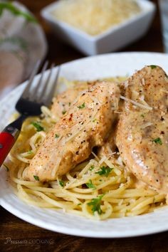 Seasoned chicken breasts fried in butter, pressure cooked until tender, served over pasta in a decadent cream sauce.