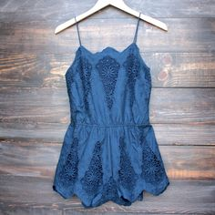 "Crochet and embroidery detail overlay navy romper with tonal lining. Cinched elastic waist. - Approx inseam: 3""(8cm). - 100% cotton. - Hand wash. - Imported."