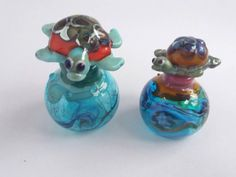 Check out this item in my Etsy shop https://www.etsy.com/uk/listing/465984056/hand-blown-miniature-perfume-bottles-by