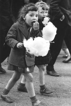 Love this photo.  Personally I always hated cotton candy.  Kind of like putting spider webs or fiberglass in your mouth....  and then it immediately dissolves.  Never liked that I couldn\'t \'eat\' it