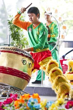 A drummer in a Chinese New Year lion dance, Kuala Lumpur, Malaysia.  The Lion Dance by Ahmed Yousry