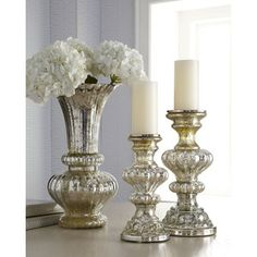 Mercury Glass accents: candle holders, vases, jars, spheres and picture frames - bring shine and sparkle to your dining table, buffet and console.