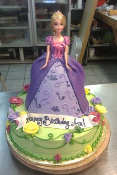 "Rapunzel doll cake on a 12"" round single layer cake with buttercream roses."