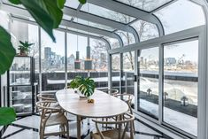 Peart/Weisgerber Residence at Habitat 67 by Moshe Safdie renovated by EMarchitecture Glass Walled Dinning Room 2