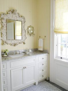 I like the white vanity, rectangle sink with the marble top.  Cool mirror and sconces too.