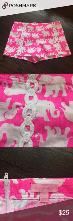 Lilly Pulitzer girls shorts Lilly Pulitzer girls shorts. Size 10. All cotton. Zips in back. Adjustable waist. Pink and white elephant print. Please note purple speck in pictures is a defect of my phone not the clothing. Lilly Pulitzer Bottoms Shorts