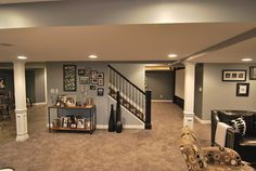 Macomb Twp Basement - contemporary - basement - detroit - by Plan-2-Finish, Inc.  I like the open stairs and the color paint...