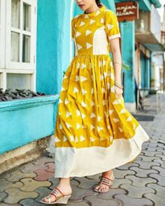 Shop online Yellow block dress Yellow and white maxi dress with contrast princess panel. The dress has short sleeves with band collar. It is perfect for any occasion White Maxi Dresses, Trendy Dresses, Cotton Dresses, Maxi Gowns, Indian Designer Outfits, Designer Dresses, Yellow Shorts Outfit, Krishna, Ikkat Dresses