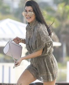 Better: Fortunately sister Kourtney did not follow her lead, wearing a short summer dress over her bikini