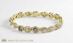 This 18k Yellow gold Champagne Halo Diamond Bracelet features brown diamonds with white diamond halos.