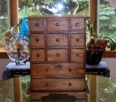 """11 Drawer Apothecary Spice Chest Mahogany Finish by americana-r-us. $139.95. 11 Drawer Apothecary,Sewing, Spice, Jewerly Chest. Three sized Drawers. Shaker Style Design. 20 1/2"""" High x 15 1/2"""" Long x 14"""" Wide. Mahogany Finish. Wood 11 Drawer Apothecary/Spice Chest in a Rich Mahogany Finish. The Chest measures 20 1/2"""" High x 15 1/2"""" Long x 14"""" Wide. Three size Drawers measuring as follows (2) bottom drawers - 13"""" Long x 12 1/2"""" Wide, (3) Center drawers - 13"""" Long x 5"""" Wide and (6)..."""