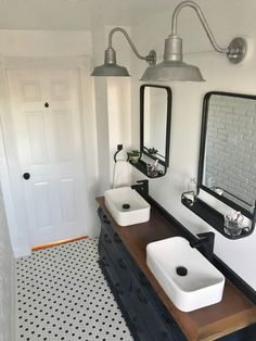 Installed above the vanity, farmhouse bathroom lighting contributes authentic industrial details and an elevated style to this era house. Farmhouse Bathroom Light, White Bathroom, Modern Farmhouse, Farmhouse Style, Neutral Bathroom, Farmhouse Lighting, Farmhouse Interior, Teen Boy Bathroom, Guys Bathroom