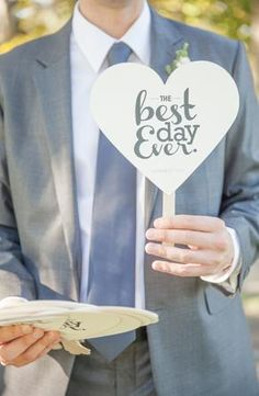 """Best Day Ever"" heart fans for outdoor wedding."