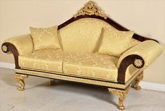 This sofa was clearly inspired by ancient Egypt. The gold colours and details make it reflect the Egyptian style very well. This piece could fit well in modern times or ancient times.