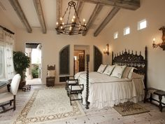 Elegant master with cream and brown color scheme & wood beam ceiling. #design #decor #home #bedroom #interiors #luxury