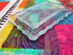 "Stamping with Gelli Plates!  All you need to do is press the 3""x5"" Gelli plate onto a smooth, flat plastic or acrylic surface — like an old CD case or acrylic stamping block — and you're good to go. It's that easy!"