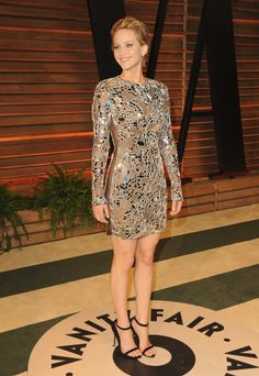 Jennifer Lawrence wore a short metallic dress at the Vanity Fair Oscars party.