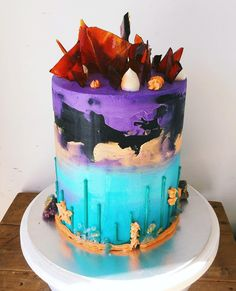 Upside down aqua drip, ocean with buttercream coral and starfish, gold dusted rock sugar and geodes, leading up to the night sky and topped with a full crown of toffee shards.
