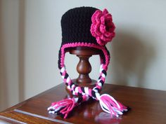 3c3326f0978 Items similar to Newborn Black Crochet Earflap with Pink Flower on Etsy