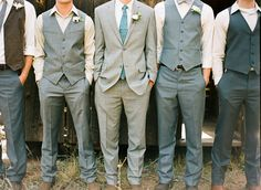 This is a great example of formal and casual blended look for the guys. Example: If you ask the guys to wear grey dress slacks( any shade) with the matching vest, and a white dress shirt ( no tie) ... but the Groom wears grey dress slacks with the matching jacket and a tie. Perfect!