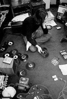 John Lennon listening to records
