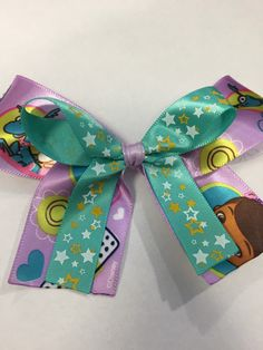 A personal favorite from my Etsy shop https://www.etsy.com/listing/224668816/doc-mcstuffins-hair-bow